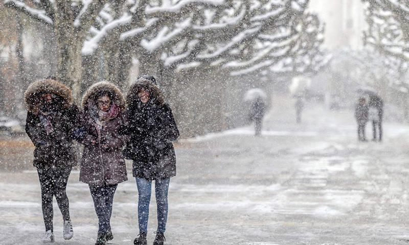 people walking in snowstorm