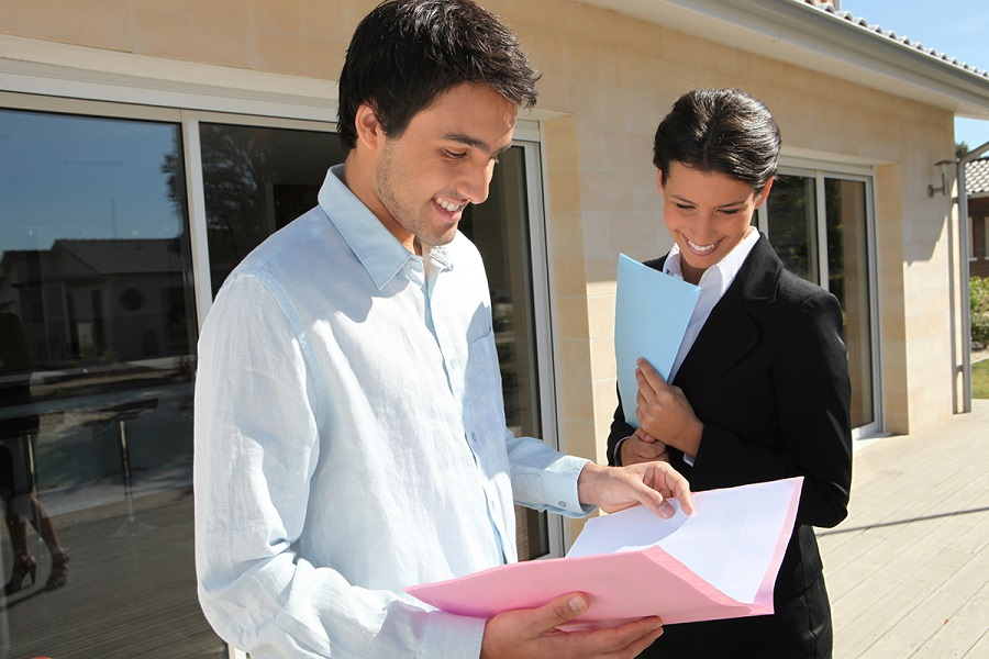 real estate agent with client